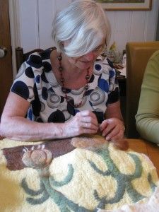 Sue top-stitching the onions
