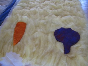 The first pre-felt shapes on the unfelted background